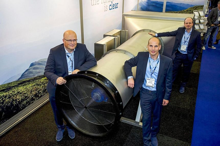 The Envinity Group's managing partners (from left) Peter van Wees, Simon van der Burg and Tim Petter with what they called the world's first giant outside air vacuum cleaner, which is designed to filter fine and ultra-fine particles from ambient air,