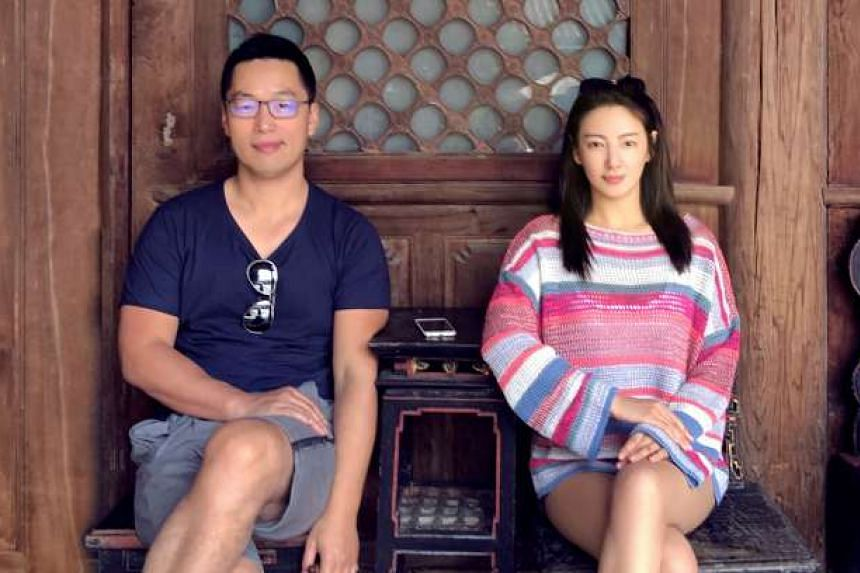 Kitty Zhang (right) and her new husband.