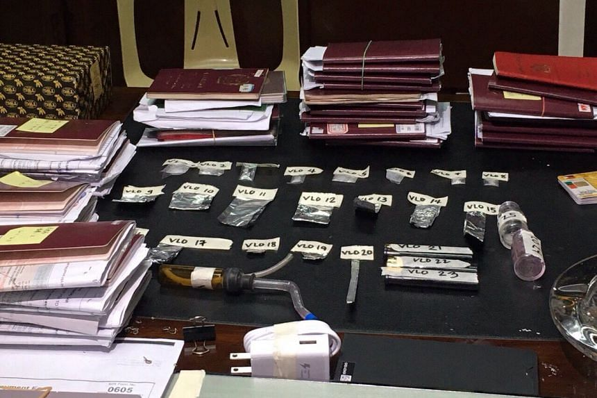 Police photo of sachets of shabu and other drug paraphernalia, passports and travel documents seized from 61 foreigners arrested in a drug raid on Oct 26, 2016 evening at the office of Haoying Solutions in the prime Philippine financial district of M