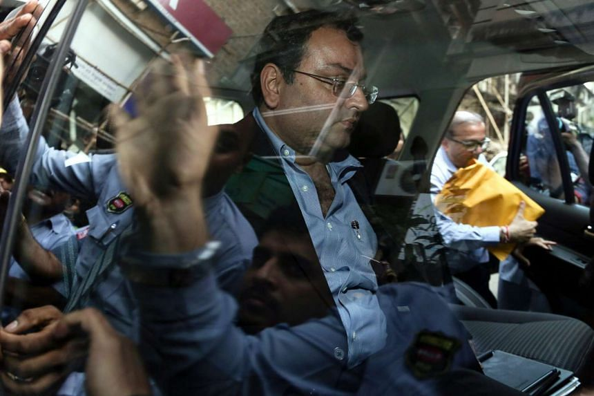 Cyrus Mistry, former chairman of Tata Sons, leaves after attending a meeting at the company's head office in Mumbai.