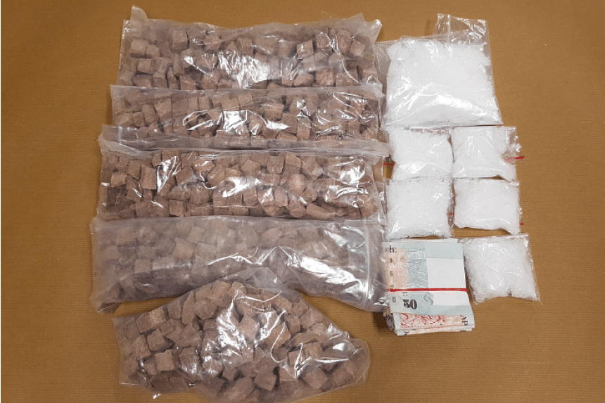 Heroin, Ice and cash seized by the Central Narcotics Bureau (CNB) on Oct 26.