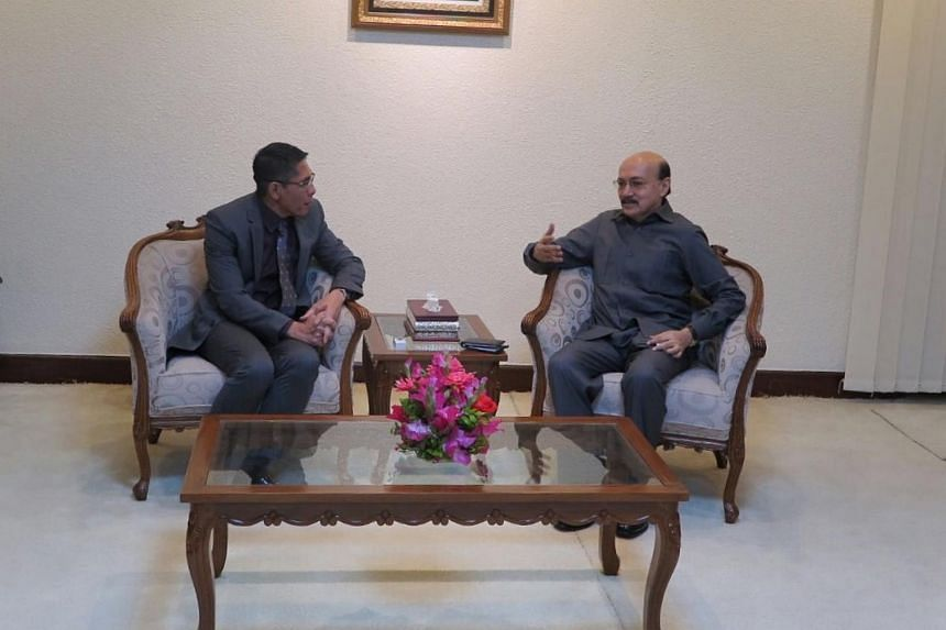 Senior Minister of State Maliki Osman speaking with the Defence and Security Adviser to the Prime Minister, Mr Tarique Ahmed Siddique.