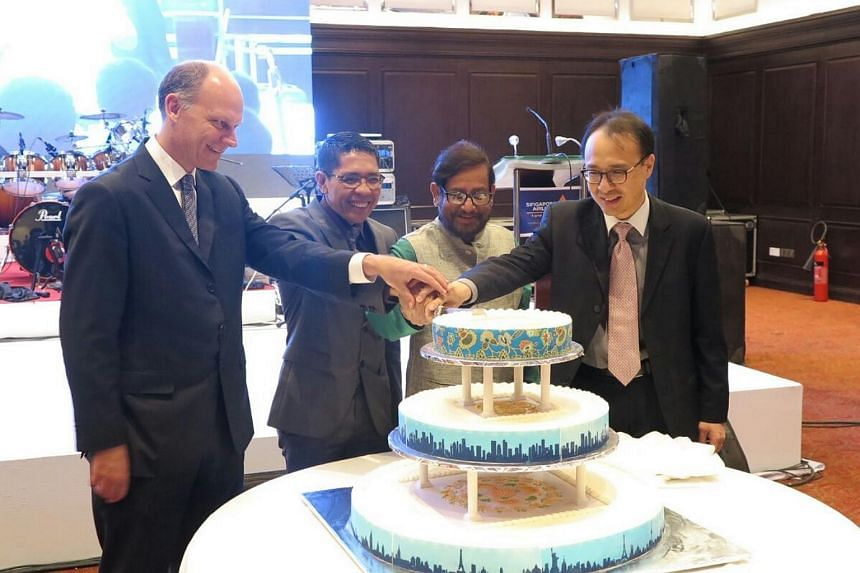 Senior Minister of State Maliki Osman (second left) with Bangladesh's Minister for Culture Asaduzzaman Noor (second right) and senior SIA staff at the airline's celebration of 30 years of operation in Bangladesh.