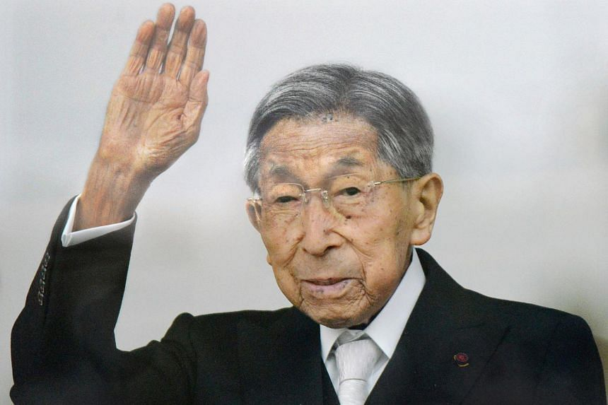 Japanese Prince Mikasa waves to well-wishers during a public appearance for a New Year celebration at the Imperial Palace in Tokyo on Jan 2, 2015.