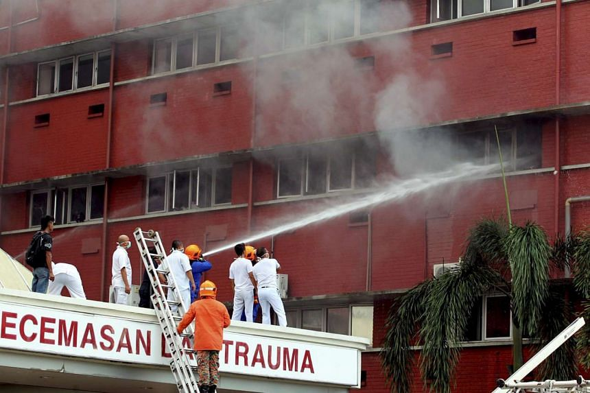 Firefighters putting out a fire on the second floor of the Sultanah Aminah Hospital in Johor Baru on Oct 25, 2016.