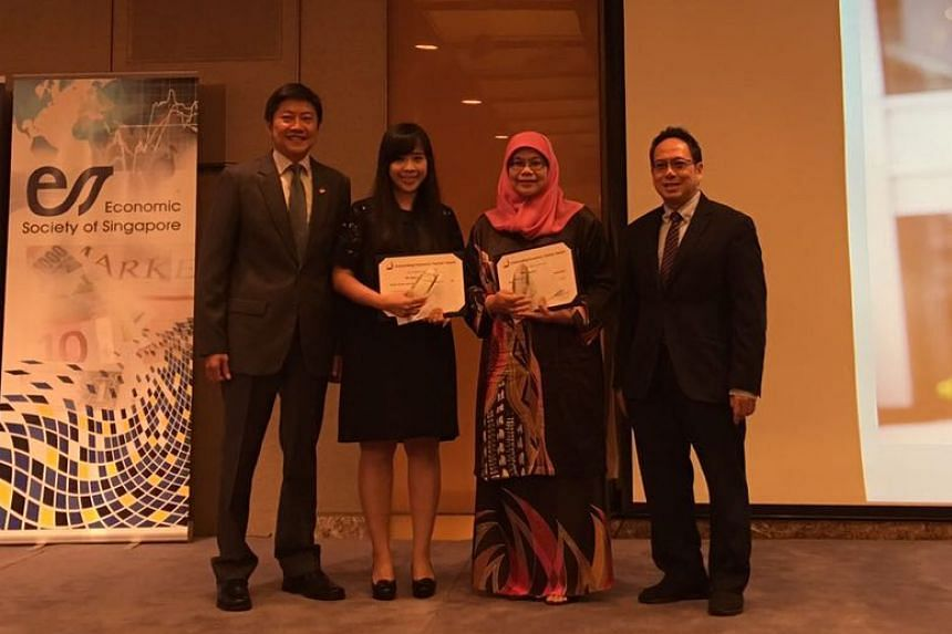 Winners of the inaugural Outstanding Economics Teacher Award:  Ms Deborah How, head of arts at Hwa Chong Institution (2nd from left) and Mdm Rahimah binte Salim, lead teacher of economics at Anglo-Chinese Junior College (2nd from right).