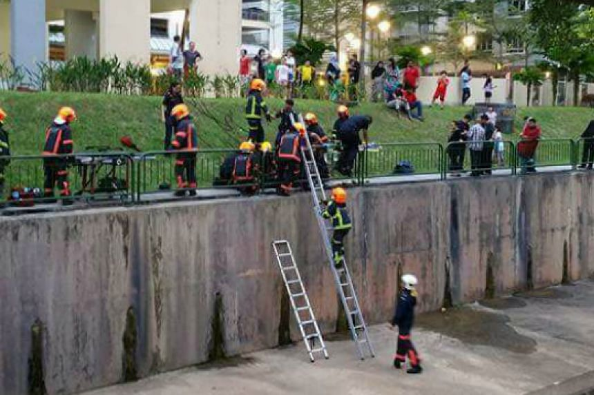 Singapore Civil Defence Force rescue of a man who fell into a canal at Segar Road on Oct 22, 2016.
