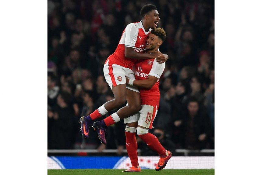 Arsenal's Alex Oxlade-Chamberlain (No. 15) celebrates scoring his second goal with Alex Iwobi. That effort in the 78th minute took his season's tally to five goals. He also opened the scoring in the 34th minute.