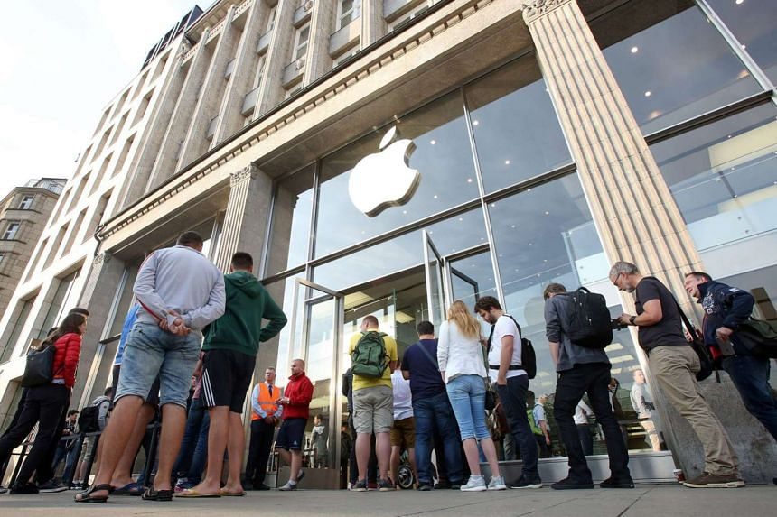 Customers queueing outside an Apple store at the start of iPhone 7 sales in Germany last month. Investors were rattled when Apple said it was caught off guard by how many people wanted to buy the iPhone 7 Plus and the miscalculation may hit profits.