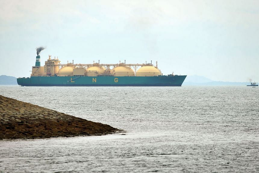 An LNG tanker off the southern coast of Singapore. LNG supplies can now be transported via specially designed ships that can carry the gas in liquefied form, as opposed to the traditional method via pipes.