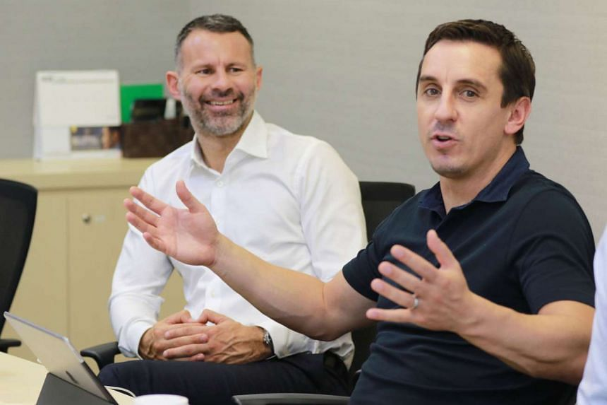 Former Man U stars Ryan Giggs (in white) and Gary Neville at a press briefing yesterday outlining their business plans for Singapore.