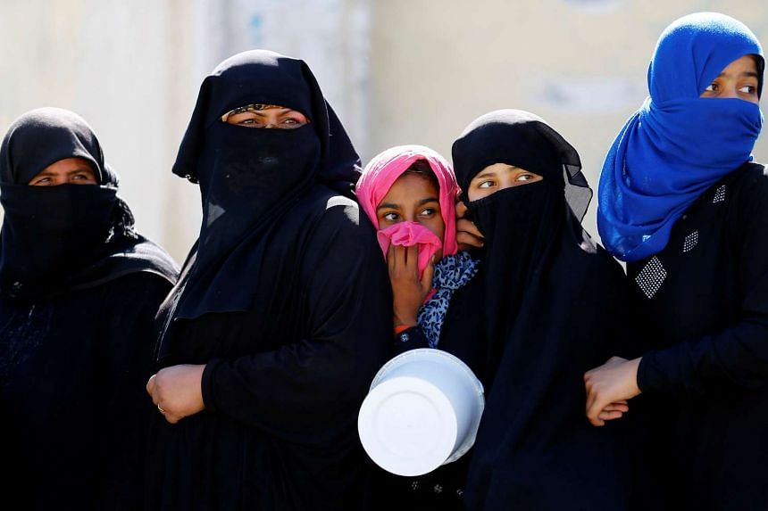 Syrian women line up for food distribution in the border town of Jarablus, Syria on Oct 19, 2016.