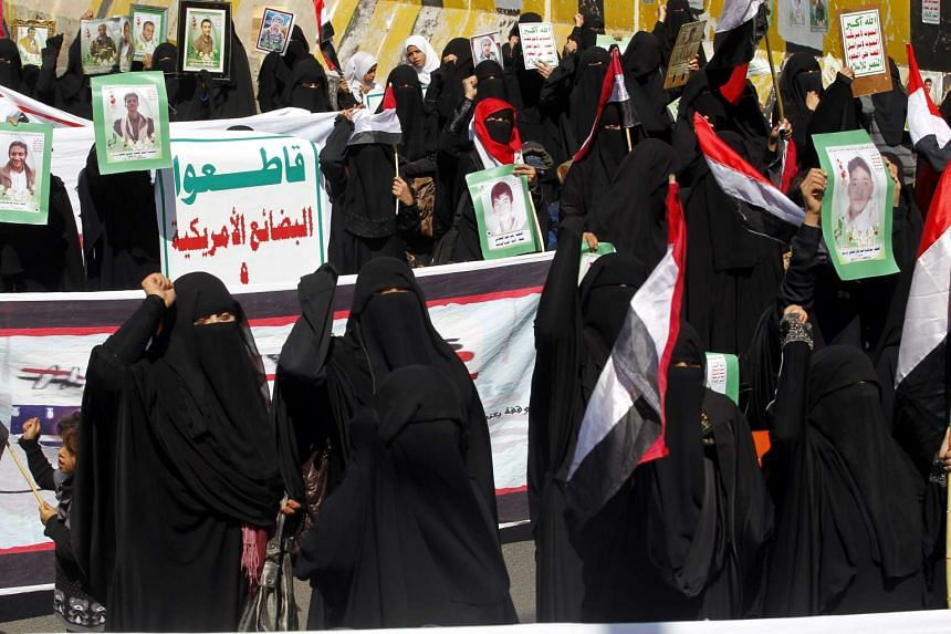 Yemeni women shout slogans during a rally against Saudi-led military operations in the country, in Sana'a, Yemen, on Oct 25, 2016.