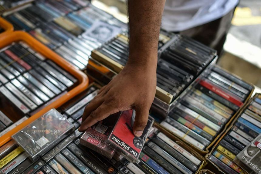A collector browsing audio cassettes in Subang Jaya, on the outskirts of Kuala Lumpur on Oct 8, 2016.