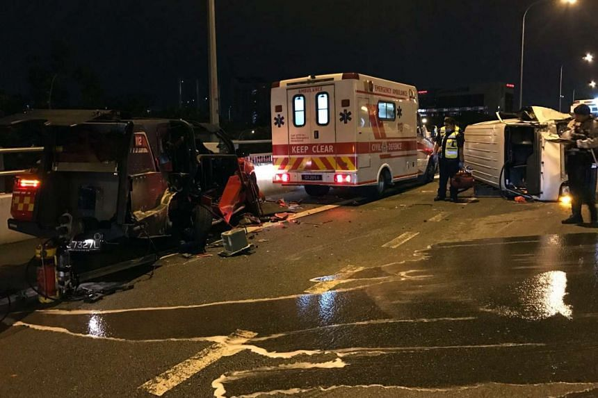 The toppled van that collided into a stationary SCDF Red Rhino fire vehicle.