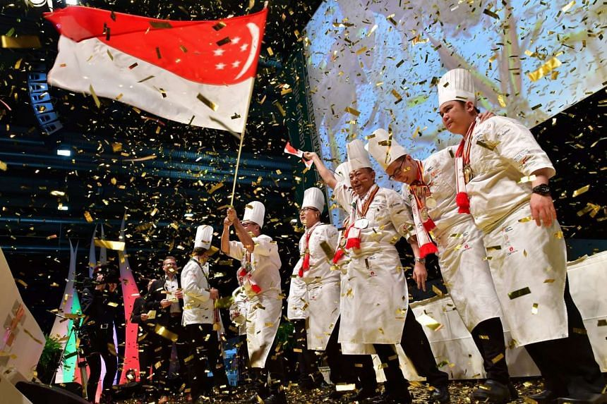 Singapore's national culinary team celebrate after winning the competition during the awards ceremony of the International Culinary Olympics in Erfurt, Germany, on Oct 26, 2016.