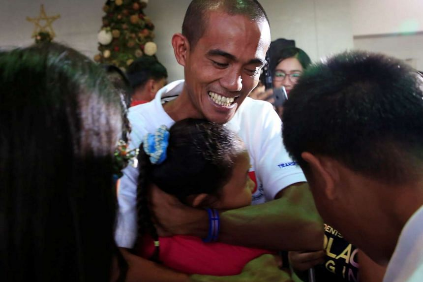 Arnel Pregillana Balbero, one of the Filipino seafarers released from the captivity of Somali pirates after nearly five years, is hugged by his loved ones at the Ninoy Aquino International Airport on Oct 28, 2016.