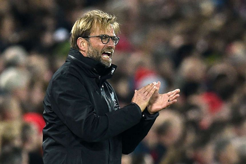 Liverpool manager Jurgen Klopp gestures on the touchline during the English Football League Cup match against Tottenham Hotspur at Anfield on Oct 25, 2016.