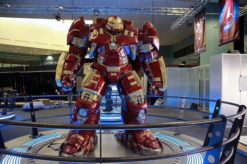 The Hulkbuster supersuit (left) on display at the Marvel's Avengers S.T.A.T.I.O.N exhibition; and an interactive station on the workings of Hulk's brain (far left).