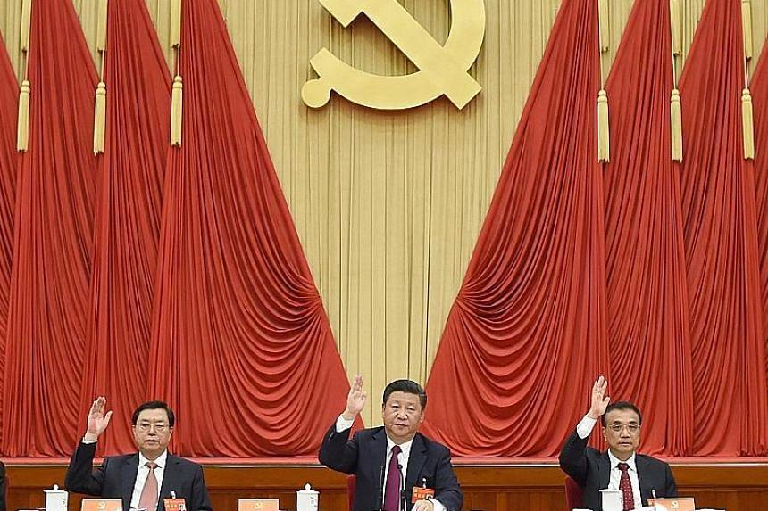 (From left) National People's Congress Standing Committee chairman Zhang Dejiang, President Xi Jinping and Premier Li Keqiang.