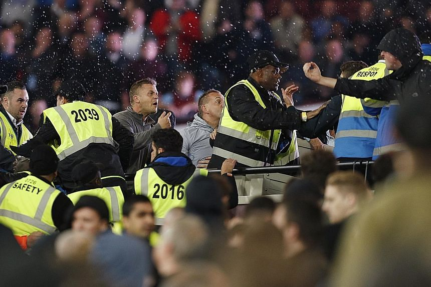 Stewards struggling to contain fans of West Ham and Chelsea at the London Stadium. Both clubs have promised to give life bans to supporters found guilty of wrongdoing.