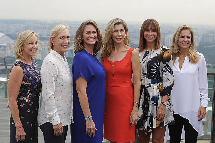All smiles high up at the observatory deck of the Marina Bay Sands SkyPark are (from left) Chris Evert, Martina Navratilova, Mary Pierce, Monica Seles, Iva Majoli and Arantxa Sanchez-Vicario. The former Grand Slam champions are in town for the WTA Fi