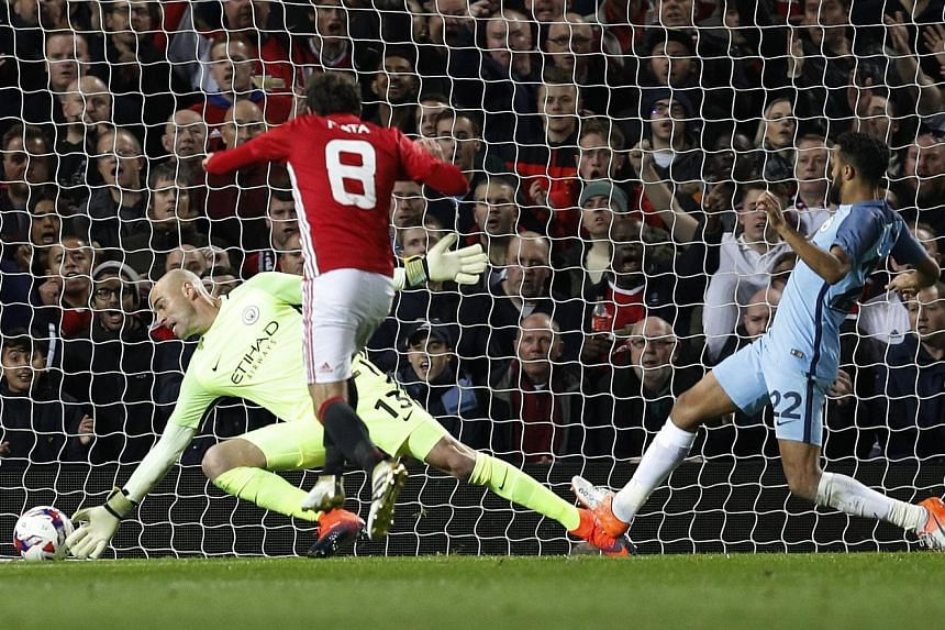 """""""We're back,"""" says Juan Mata of Manchester United, after scoring the only goal of their League Cup fourth-round tie against Manchester City. While Pep Guardiola fielded a second-string side, he has now gone six games without a win - the longest stret"""