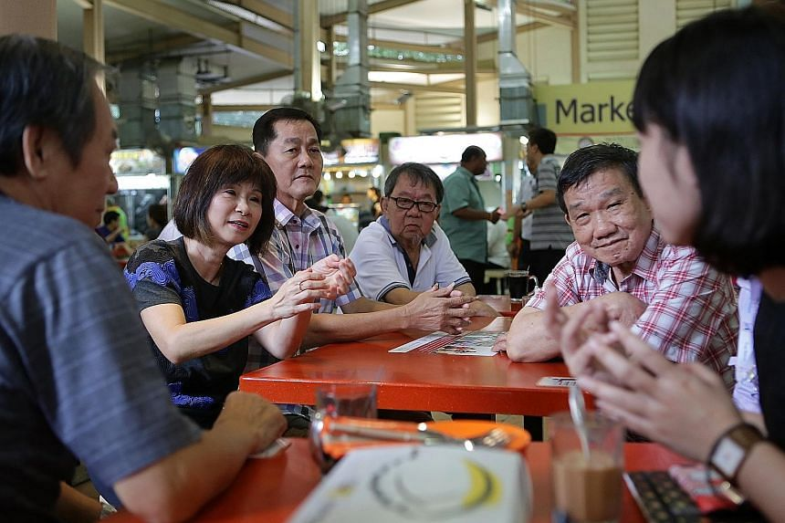 Dr Amy Khor getting feedback from hawkers yesterday to help with the Government's plans for the future of hawker centres.