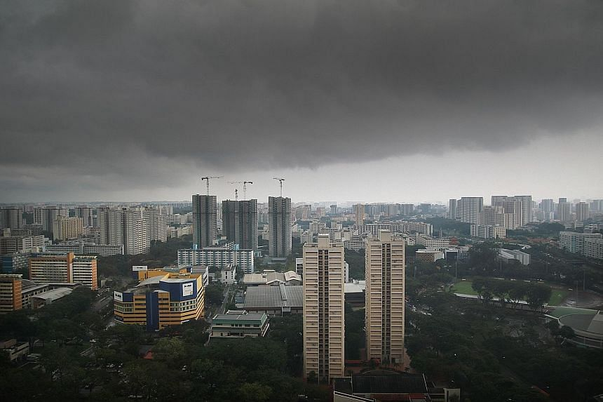 Dark skies over Toa Payoh yesterday afternoon. The wet weather will persist until the end of the month, with more thundery showers in the hours before dawn and in the morning. Most of the rainfall in the first two weeks of this month was due to Sumat
