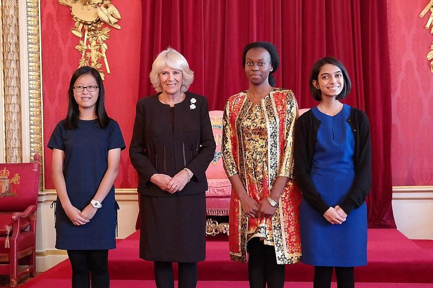At Buckingham Palace on Wednesday, the Duchess of Cornwall (second from left) presented three of the winners with certificates for their writing skills. They are (from left) Tan Wan Gee, Esther Mungalaba and Gauri Kumar.