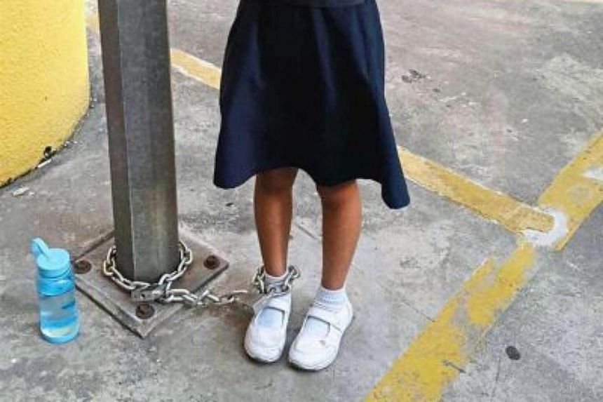 The image showing a Malaysian schoolgirl chained to a lamp post by her mother went viral and riled up netizens on social media.