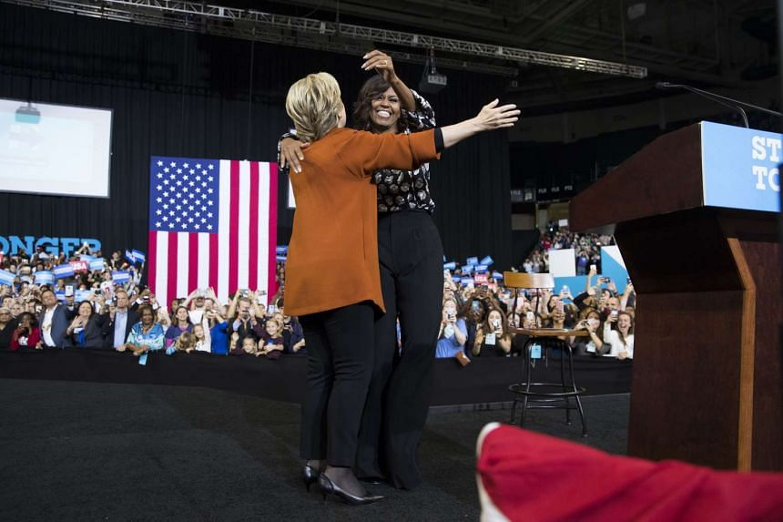 Hillary Clinton embraces first lady Michelle Obama during a campaign event at Wake Forest University in Winston-Salem, N.C., on Oct. 27, 2016. Beginning with her speech at the Democratic National Convention, Obama has sought to make a compelling, op
