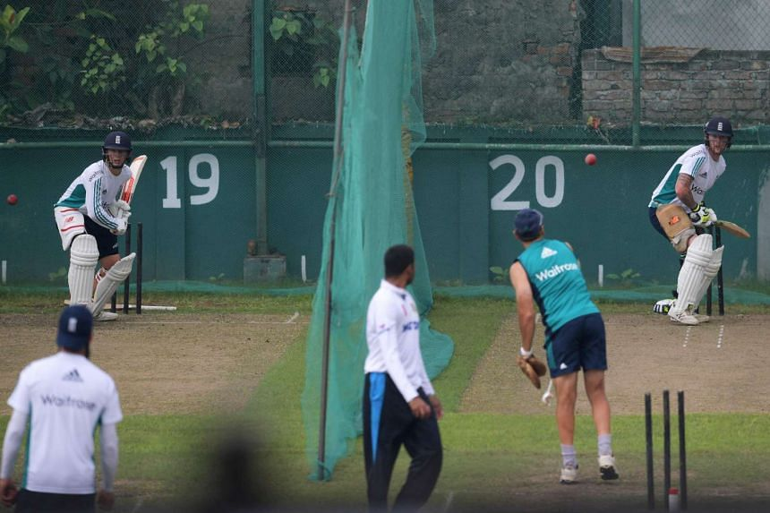 England's Gary Ballance (left) and Ben Stokes (right) bat in the nets during a training session at the Sher-e-Bangla National Cricket Stadium in Dhaka on Oct 27, 2016, on the eve of the second Test match between Bangladesh and England.
