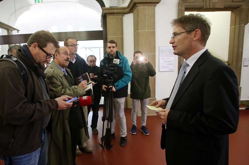 The spokesman of the district and regional court Duisburg, Rolf Rausch (right), answers questions of journalists in Duisburg, Germany on Oct 27 October. He informed the public on the judge's decision concerning a baby that was offered for sale on eBa