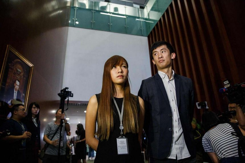 Newly elected lawmakers Yau Wai-ching (left) and Baggio Leung (right) prepare to hold a press conference after they were not allowed to take their Legislative Council oaths in Hong Kong on Oct 26, 2016.