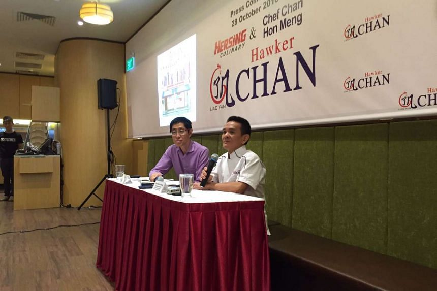 Harry Chua, chairman of Hersing Culinary (left) and Chan Hon Meng, owner-chef of Michelin-starred hawker stall, Liao Fan Hong Kong Soya Sauce Chicken Rice & Noodle, at the press conference on their partnership.