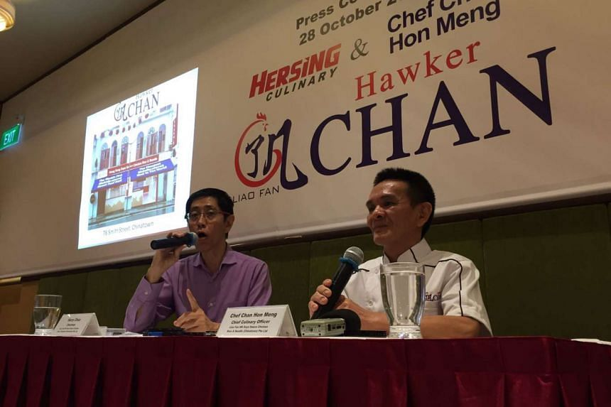 Harry Chua, chairman of Hersing Culinary (left) speaks beside Chan Hon Meng, owner-chef of Michelin-starred hawker stall, Liao Fan Hong Kong Soya Sauce Chicken Rice & Noodle, at the press conference on their partnership.