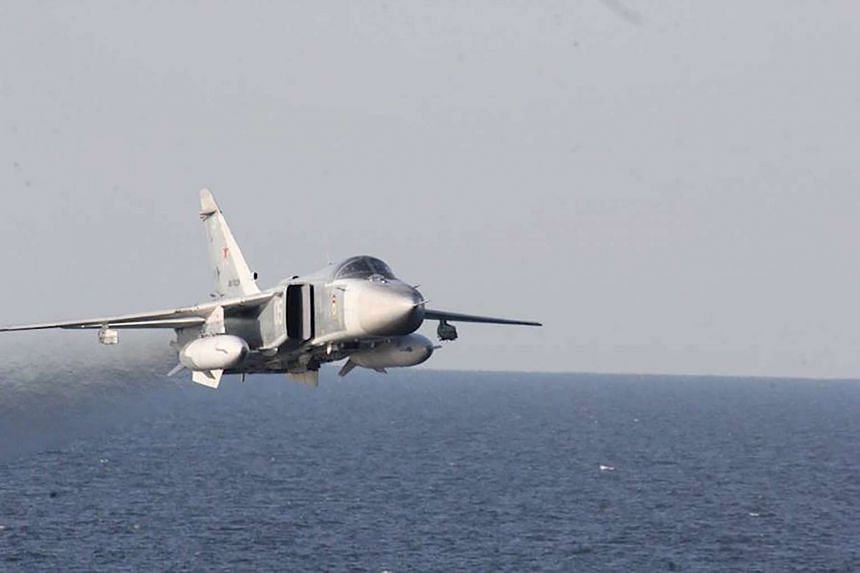 A Russian Sukhoi Su-24 attack aircraft flying over the USS Donald Cook (DDG 75), an Arleigh Burke-class guided-missile destroyer, operating in the Baltic Sea on April 12, 2016.