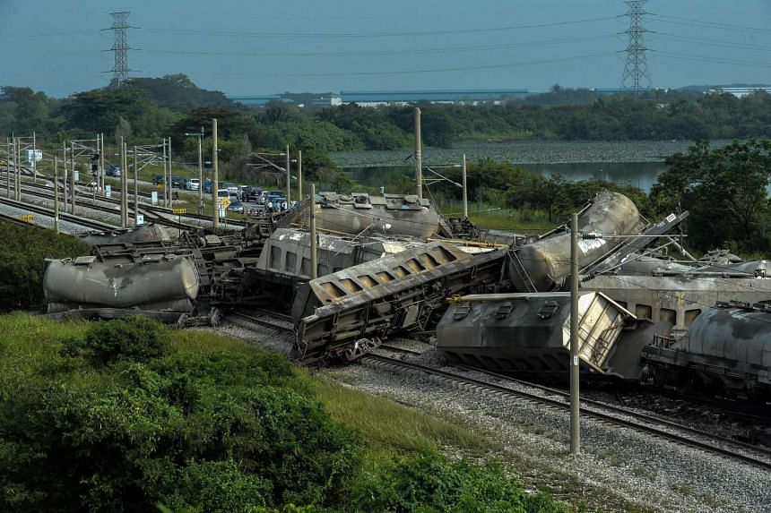 A cargo train is seen after it derailed along a heavily travelled north-south rail corridor in the northern state of Perak on Oct 28, 2016.