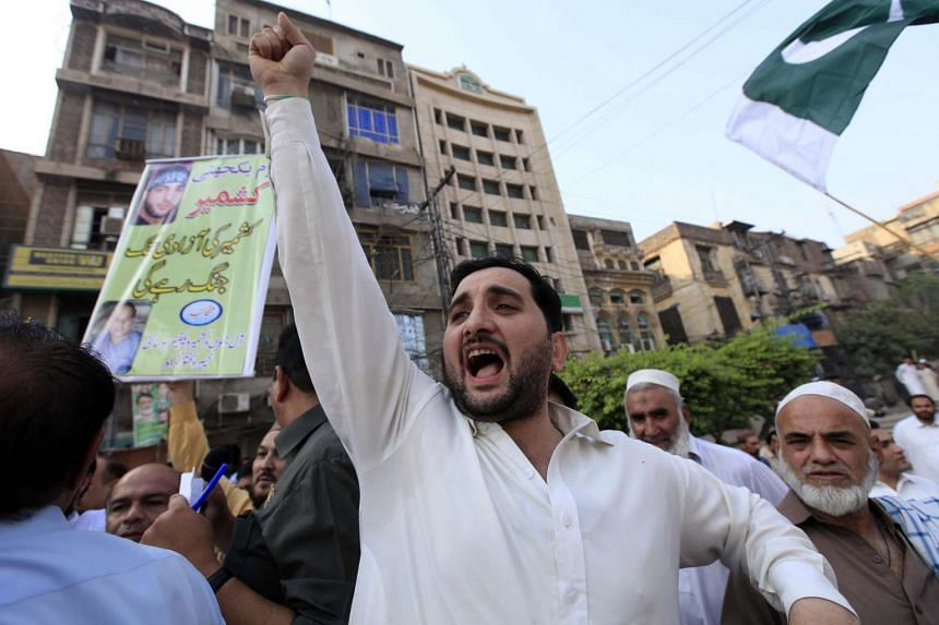 People shout slogans during a protest against India, in Peshawar, Pakistan on Ocr 21. Relations between India and Pakistan have been tense since at least two Pakistani soldiers were killed while one Indian soldier was captured during firing at the Lo