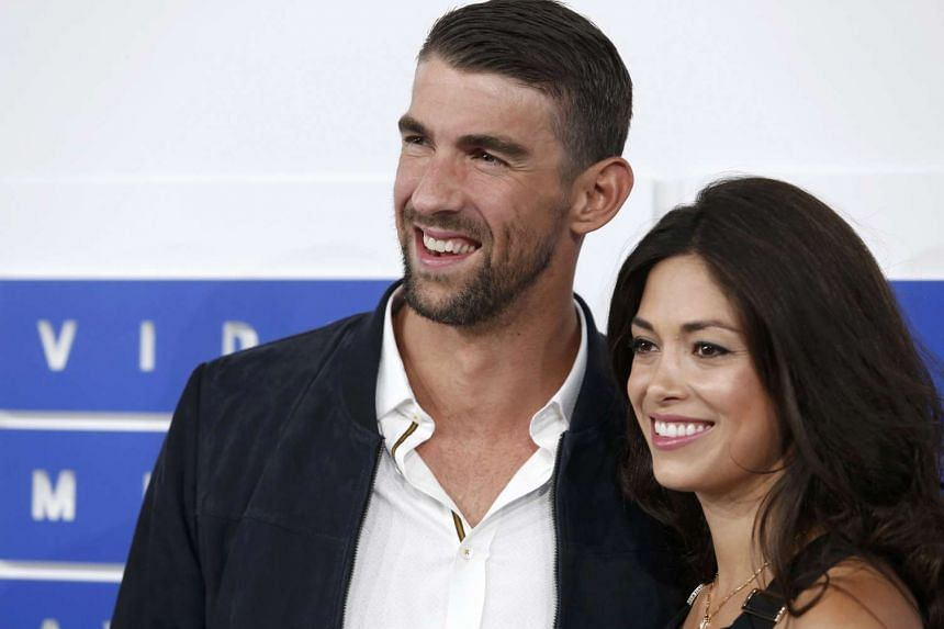 Olympic swimmer Michael Phelps and girlfriend Nicole Johnson secretly got married in June, weeks after the birth of the couple's son, Boomer, documents obtained by multiple US media outlets indicated.