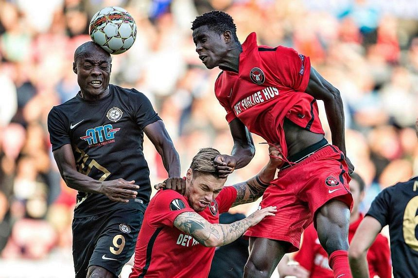 Paul Onuachu (right) of FC Midtjylland and Pierre Webo (left) of Osmanlispor vie for the ball during the Uefa Europa League Play-Off first leg match between FC Midtjylland and Osmanlispor on Aug 18, 2016.