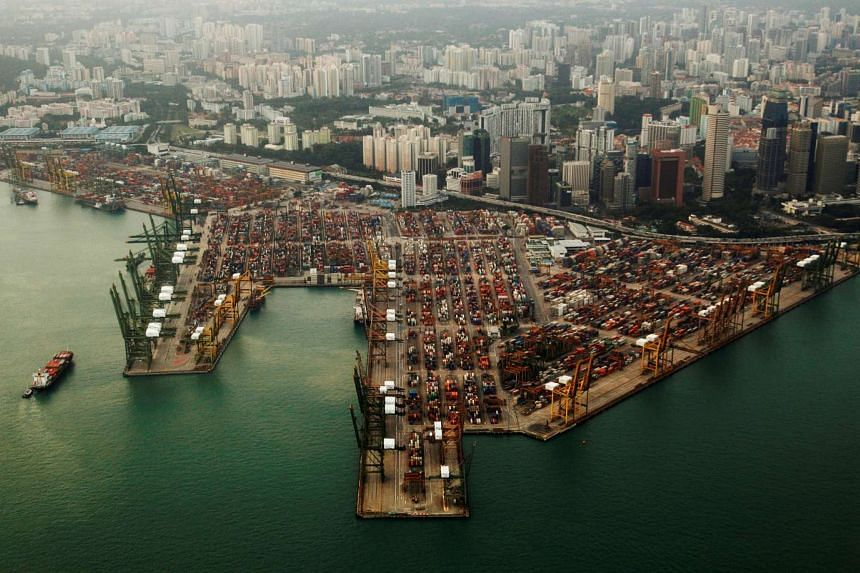 An aerial view of shipping containers stacked at the port of Singapore on Feb 14, 2012.