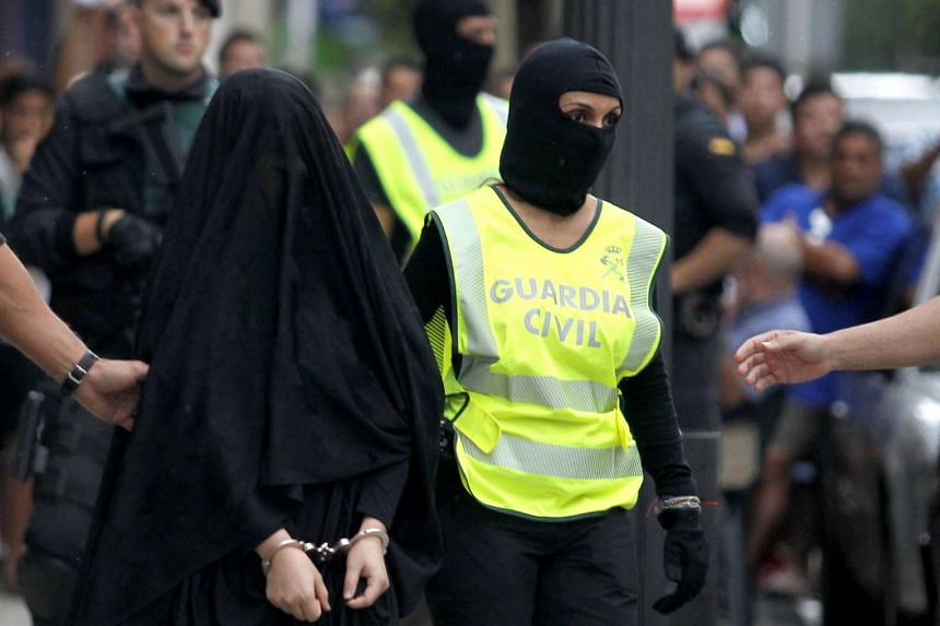 Spanish police arresting a Moroccan woman suspected of recruiting other women into ISIS. The terror group actively exploits gender inequality to aid recruitment and operations. Among other things, it encourages use of the burqa to avoid suspicion and get