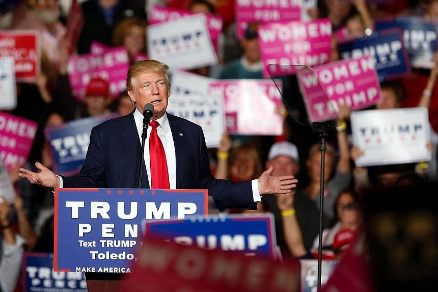 Republican presidential nominee Donald Trump speaks on stage at a campaign rally in Toledo, Ohio.