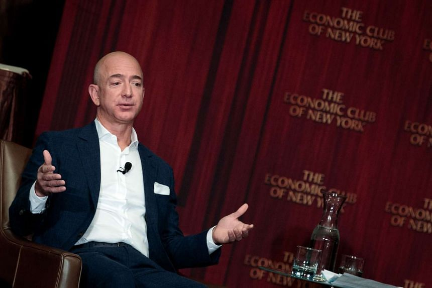 Jeff Bezos, chairman and founder of Amazon.com and owner of The Washington Post, addresses the Economic Club of New York, at the Sheraton New York Times Square Hotel on October 2.