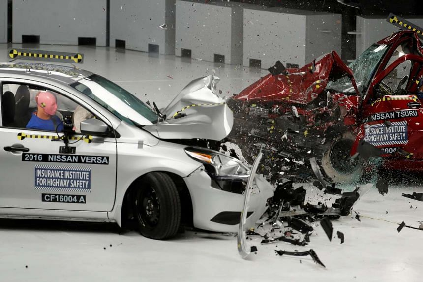 A 2016 Nissan Versa (left) and a 2015 Nissan Tsuru collide in a controlled crash test at the Insurance Institute for Highway Safety facility in Ruckersville, Virginia on Oct 27, 2016.