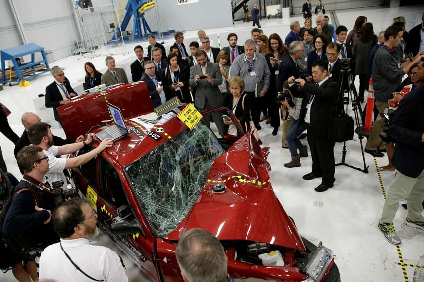 A damaged 2015 Nissan Tsuru after a controlled crash test at the Insurance Institute for Highway Safety facility in Ruckersville, Virginia on Oct 27, 2016.