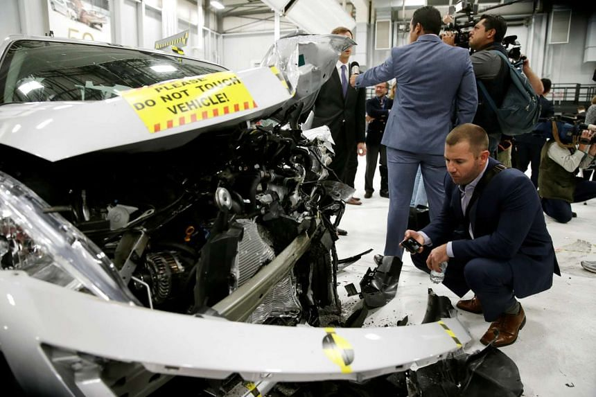 A damaged 2016 Nissan Versa after a controlled crash test at the Insurance Institute for Highway Safety facility in Ruckersville, Virginia on Oct 27, 2016.