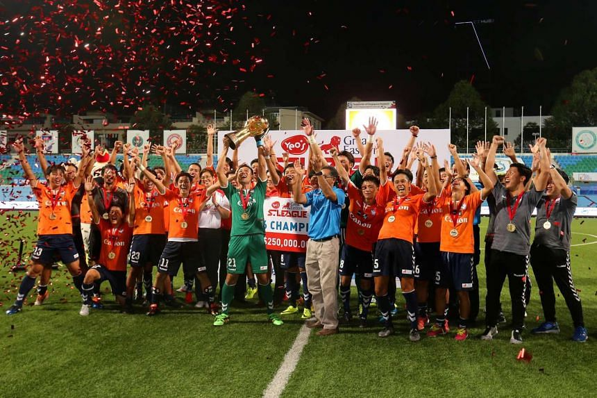 Albirex Niigata's players and staff celebrating with the S-League trophy in Jalan Besar Stadium on Oct 26, 2016.
